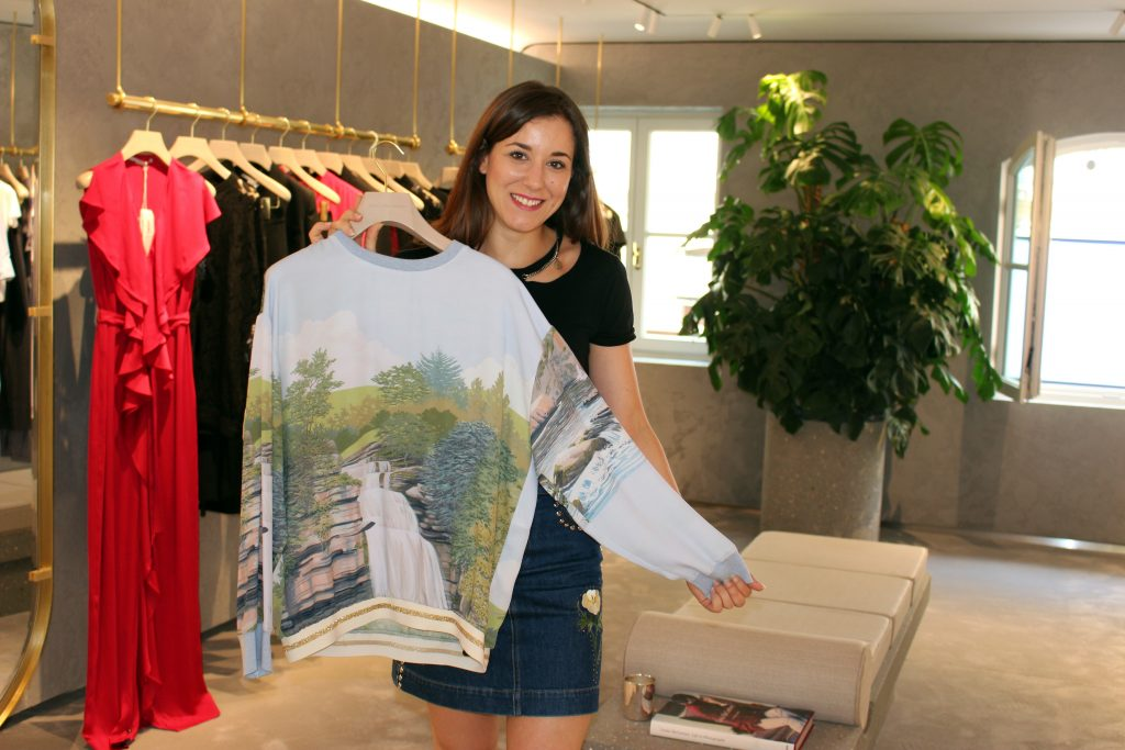 "Inês Martins, the store manager with ""her"" Inês top!"